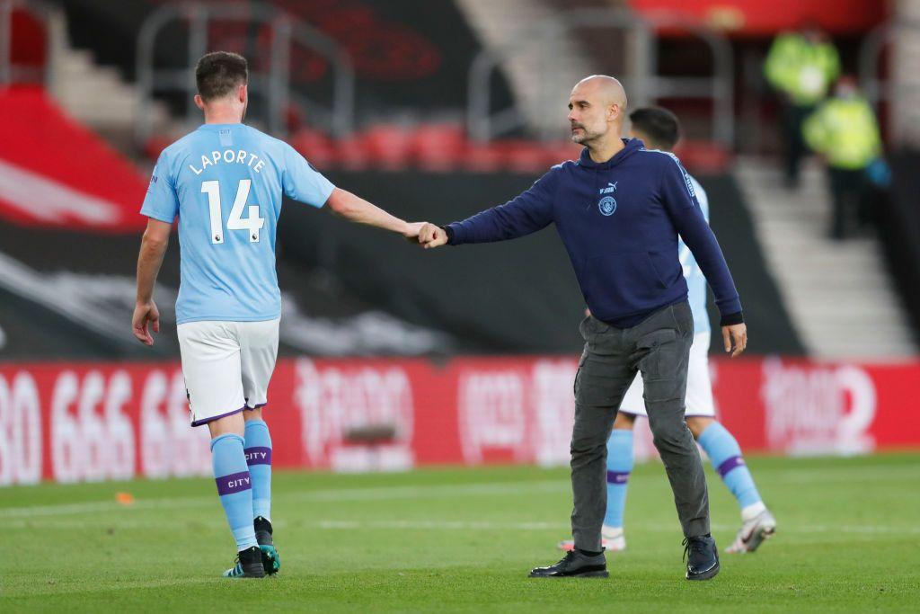 SOUTHAMPTON, ENGLAND - JULY 05: Aymeric Laporte of Manchester City shakes hands with Pep Guardiola, Manager of Manchester City following the Premier League match between Southampton FC and Manchester City at St Mary's Stadium on July 05, 2020 in Southampton, England. Football Stadiums around Europe remain empty due to the Coronavirus Pandemic as Government social distancing laws prohibit fans inside venues resulting in games being played behind closed doors. (Photo by Frank Augstein/Pool via Getty Images)