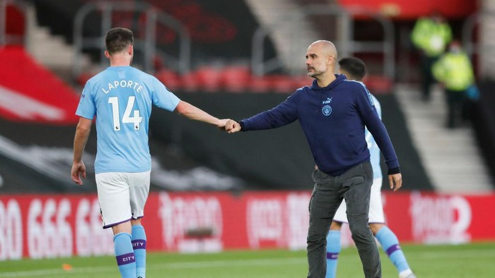 SOUTHAMPTON, ENGLAND - JULY 05: Aymeric Laporte of Manchester City shakes hands with Pep Guardiola, Manager of Manchester City following the Premier League match between Southampton FC and Manchester City at St Marys Stadium on July 05, 2020 in Southampton, England. Football Stadiums around Europe remain empty due to the Coronavirus Pandemic as Government social distancing laws prohibit fans inside venues resulting in games being played behind closed doors. (Photo by Frank Augstein/Pool via Getty Images)