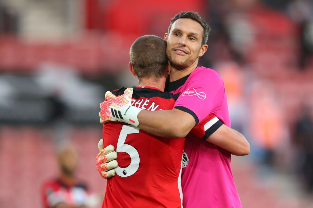 SOUTHAMPTON, ENGLAND - JULY 05: Alex McCarthy of Southampton saves from David Silva of Manchester City during the Premier League match between Southampton FC and Manchester City at St Mary's Stadium on July 05, 2020 in Southampton, England. Football Stadiums around Europe remain empty due to the Coronavirus Pandemic as Government social distancing laws prohibit fans inside venues resulting in games being played behind closed doors. (Photo by Frank Augstein/Pool via Getty Images)
