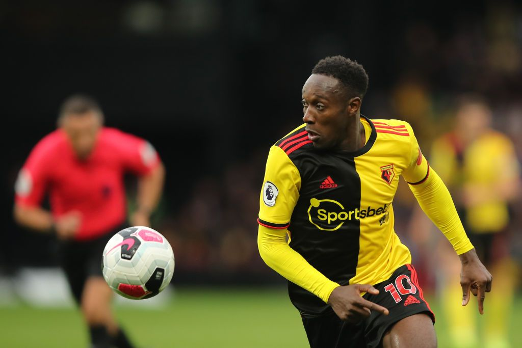WATFORD, ENGLAND - JULY 07: Danny Welbeck of Watford scores his team's second goal during the Premier League match between Watford FC and Norwich City at Vicarage Road on July 07, 2020 in Watford, England. Football Stadiums around Europe remain empty due to the Coronavirus Pandemic as Government social distancing laws prohibit fans inside venues resulting in all fixtures being played behind closed doors. (Photo by Matt Dunham/Pool via Getty Images)