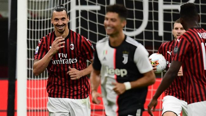 AC Milans Swedish forward Zlatan Ibrahimovic (L) reacts next to Juventus Portuguese forward Cristiano Ronaldo (C) after scoring a penalty during the Italian Serie A football match AC Milan vs Juventus played behind closed doors on July 7, 2020 at the San Siro stadium in Milan, as the country eases its lockdown aimed at curbing the spread of the COVID-19 infection, caused by the novel coronavirus. (Photo by Miguel MEDINA / AFP)