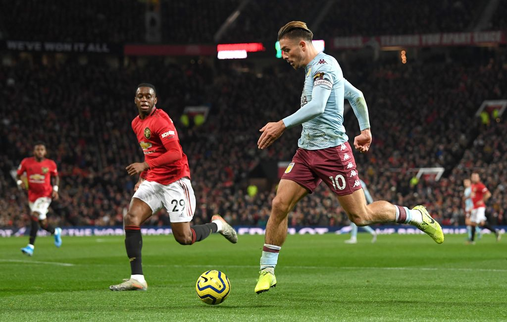 MANCHESTER, ENGLAND - DECEMBER 01: Jack Grealish of Aston Villa controls the ball as Aaron Wan-Bissaka of Manchester United looks on during the Premier League match between Manchester United and Aston Villa at Old Trafford on December 01, 2019 in Manchester, United Kingdom. (Photo by Stu Forster/Getty Images)