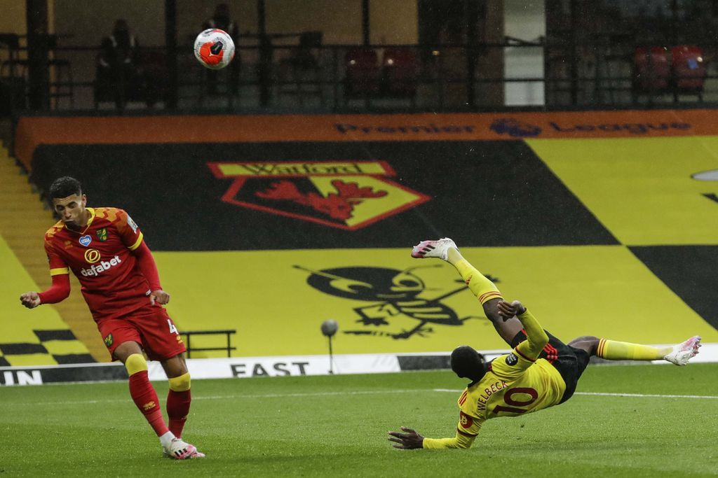 Walford's Danny Welbeck, right, scores his team second goal during the English Premier League soccer match between Watford and Norwich City at the Vicarage Road Stadium in Watford, England, Tuesday, July 7, 2020. (AP Photo/Matt Dunham, Pool)