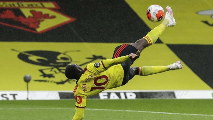 Walfords Danny Welbeck, right, scores his team second goal during the English Premier League soccer match between Watford and Norwich City at the Vicarage Road Stadium in Watford, England, Tuesday, July 7, 2020. (AP Photo/Matt Dunham, Pool)