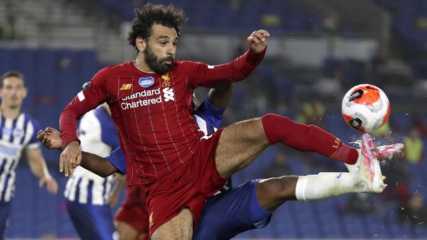 Liverpool's Mohamed Salah attempts to control the ball during the English Premier League soccer match between Brighton and Liverpool at Falmer Stadium in Brighton, England, Wednesday, July 8, 2020. (AP Photo/Catherine Ivill,Pool)