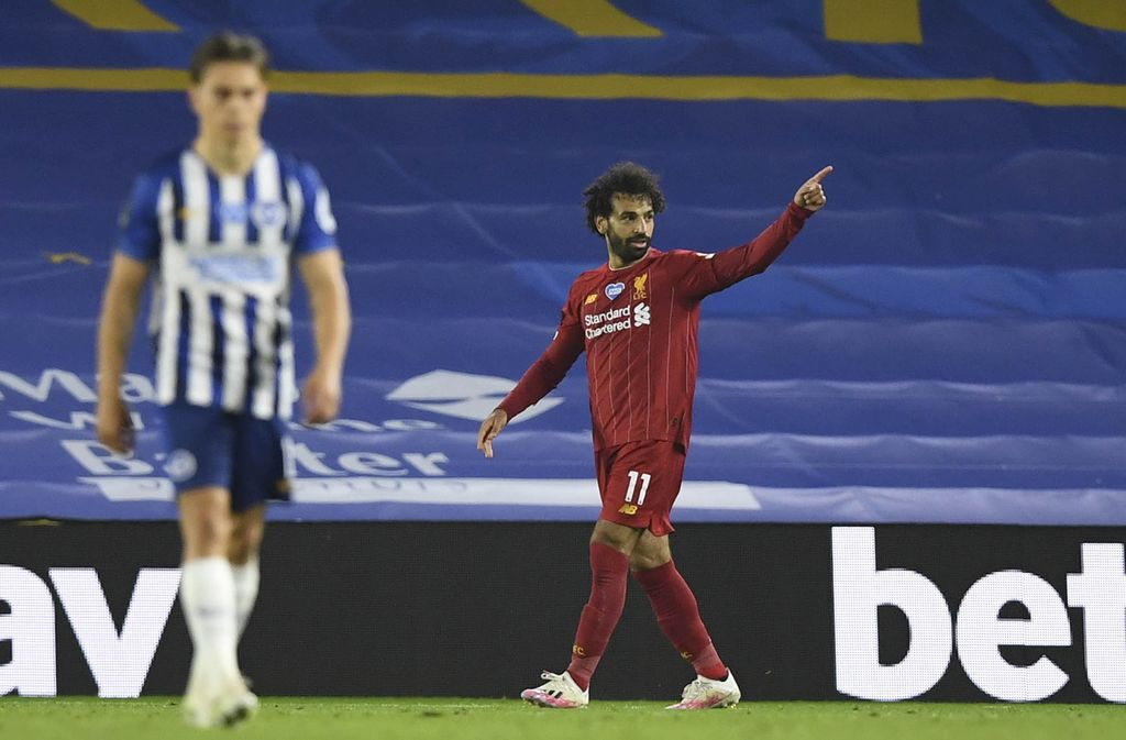 Liverpool's Mohamed Salah reacts after missing a shot at goal during the English Premier League soccer match between Brighton and Liverpool at Falmer Stadium in Brighton, England, Wednesday, July 8, 2020. (AP Photo/Paul Childs,Pool)