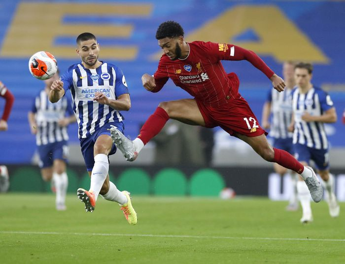 Liverpools Mohamed Salah reacts after missing a shot at goal during the English Premier League soccer match between Brighton and Liverpool at Falmer Stadium in Brighton, England, Wednesday, July 8, 2020. (AP Photo/Paul Childs,Pool)