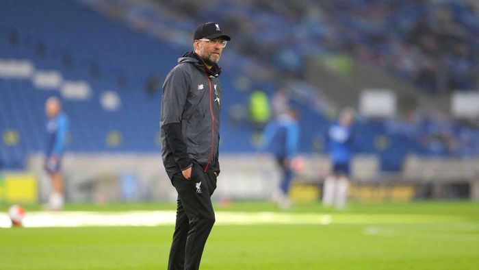 BRIGHTON, ENGLAND - JULY 08: Jurgen Klopp, Manager of Liverpool looks on ahead of the Premier League match between Brighton & Hove Albion and Liverpool FC at American Express Community Stadium on July 08, 2020 in Brighton, England. Football Stadiums around Europe remain empty due to the Coronavirus Pandemic as Government social distancing laws prohibit fans inside venues resulting in all fixtures being played behind closed doors. (Photo by Catherine Ivill/Getty Images)