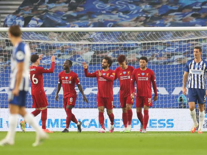 BRIGHTON, ENGLAND - JULY 08: Mohamed Salah of Liverpool celebrates after scoring his teams first goal during the Premier League match between Brighton & Hove Albion and Liverpool FC at American Express Community Stadium on July 08, 2020 in Brighton, England. Football Stadiums around Europe remain empty due to the Coronavirus Pandemic as Government social distancing laws prohibit fans inside venues resulting in all fixtures being played behind closed doors. (Photo by Catherine Ivill/Getty Images)