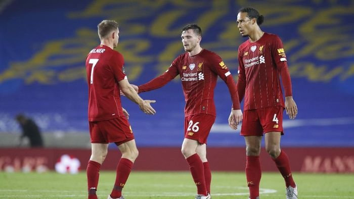 BRIGHTON, ENGLAND - JULY 08: Andy Robertson of Liverpool and Virgil van Dijk of Liverpool interacts with James Milner of Liverpool after the Premier League match between Brighton & Hove Albion and Liverpool FC at American Express Community Stadium on July 08, 2020 in Brighton, England. Football Stadiums around Europe remain empty due to the Coronavirus Pandemic as Government social distancing laws prohibit fans inside venues resulting in all fixtures being played behind closed doors. (Photo by Paul Childs/Pool via Getty Images)
