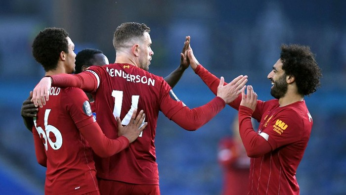 BRIGHTON, ENGLAND - JULY 08: Jordan Henderson of Liverpool celebrates with his team after scoring his sides second goal during the Premier League match between Brighton & Hove Albion and Liverpool FC at American Express Community Stadium on July 08, 2020 in Brighton, England. Football Stadiums around Europe remain empty due to the Coronavirus Pandemic as Government social distancing laws prohibit fans inside venues resulting in all fixtures being played behind closed doors. (Photo by Daniel Leal Olivas/Pool via Getty Images)