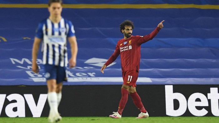 BRIGHTON, ENGLAND - JULY 08: Mohamed Salah of Liverpool celebrates after he scores his sides third goal during the Premier League match between Brighton & Hove Albion and Liverpool FC at American Express Community Stadium on July 08, 2020 in Brighton, England. Football Stadiums around Europe remain empty due to the Coronavirus Pandemic as Government social distancing laws prohibit fans inside venues resulting in all fixtures being played behind closed doors. (Photo by Daniel Leal Olivas/Pool via Getty Images)