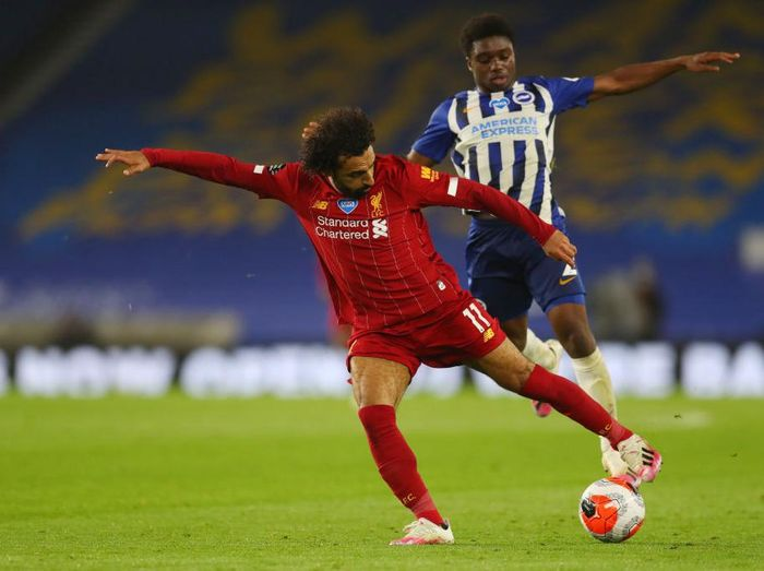 BRIGHTON, ENGLAND - JULY 08: Mohamed Salah of Liverpool reacts during the Premier League match between Brighton & Hove Albion and Liverpool FC at American Express Community Stadium on July 08, 2020 in Brighton, England. Football Stadiums around Europe remain empty due to the Coronavirus Pandemic as Government social distancing laws prohibit fans inside venues resulting in all fixtures being played behind closed doors. (Photo by Paul Childs/Pool via Getty Images)