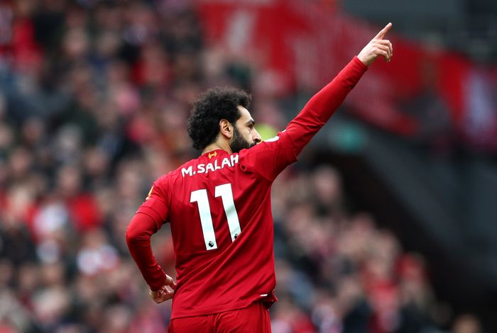 LIVERPOOL, ENGLAND - MARCH 07: Mohamed Salah of Liverpool celebrates after scoring his teams first goal during the Premier League match between Liverpool FC and AFC Bournemouth  at Anfield on March 07, 2020 in Liverpool, United Kingdom. (Photo by Jan Kruger/Getty Images)