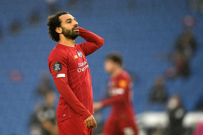 BRIGHTON, ENGLAND - JULY 08: Mohamed Salah of Liverpool reacts during the Premier League match between Brighton & Hove Albion and Liverpool FC at American Express Community Stadium on July 08, 2020 in Brighton, England. Football Stadiums around Europe remain empty due to the Coronavirus Pandemic as Government social distancing laws prohibit fans inside venues resulting in all fixtures being played behind closed doors. (Photo by Daniel Leal Olivas/Pool via Getty Images)