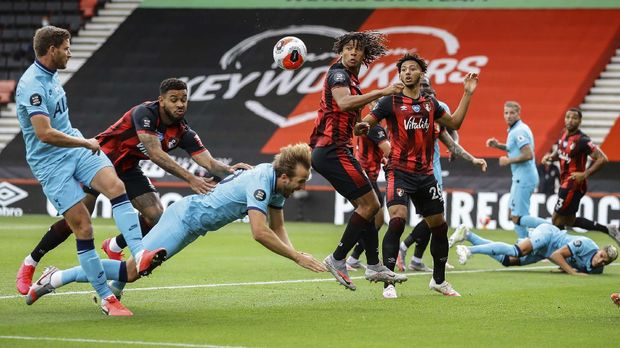 Tottenham's Harry Kane falls during the English Premier League soccer match between Bournemouth and Tottenham at the at Vitality Stadium in Bournemouth, England, Thursday, July 9, 2020. (Richard Heathcote/Pool via AP)