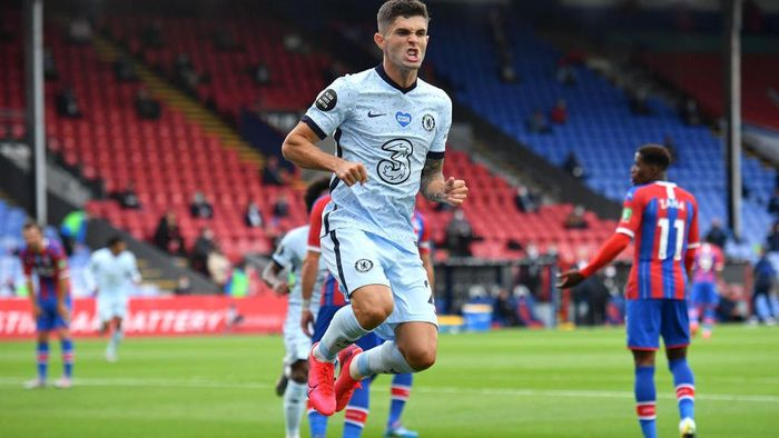 LONDON, ENGLAND - JULY 07: Christian Pulisic of Chelsea celebrates after scoring his teams second goal during the Premier League match between Crystal Palace and Chelsea FC at Selhurst Park on July 07, 2020 in London, England. Football Stadiums around Europe remain empty due to the Coronavirus Pandemic as Government social distancing laws prohibit fans inside venues resulting in all fixtures being played behind closed doors. (Photo by Justin Tallis/Pool via Getty Images)
