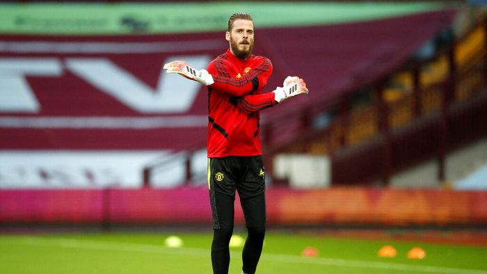 Manchester Uniteds goalkeeper David de Gea warms up ahead of the English Premier League soccer match between Aston Villa and Manchester United at Villa Park in Birmingham, England, Thursday, July 9, 2020. (AP PhotoAndrew Boyers,Pool)