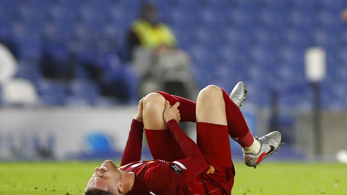 Liverpools Jordan Henderson reacts during the English Premier League soccer match between Brighton and Liverpool at Falmer Stadium in Brighton, England, Wednesday, July 8, 2020. (AP Photo/Paul Childs,Pool)