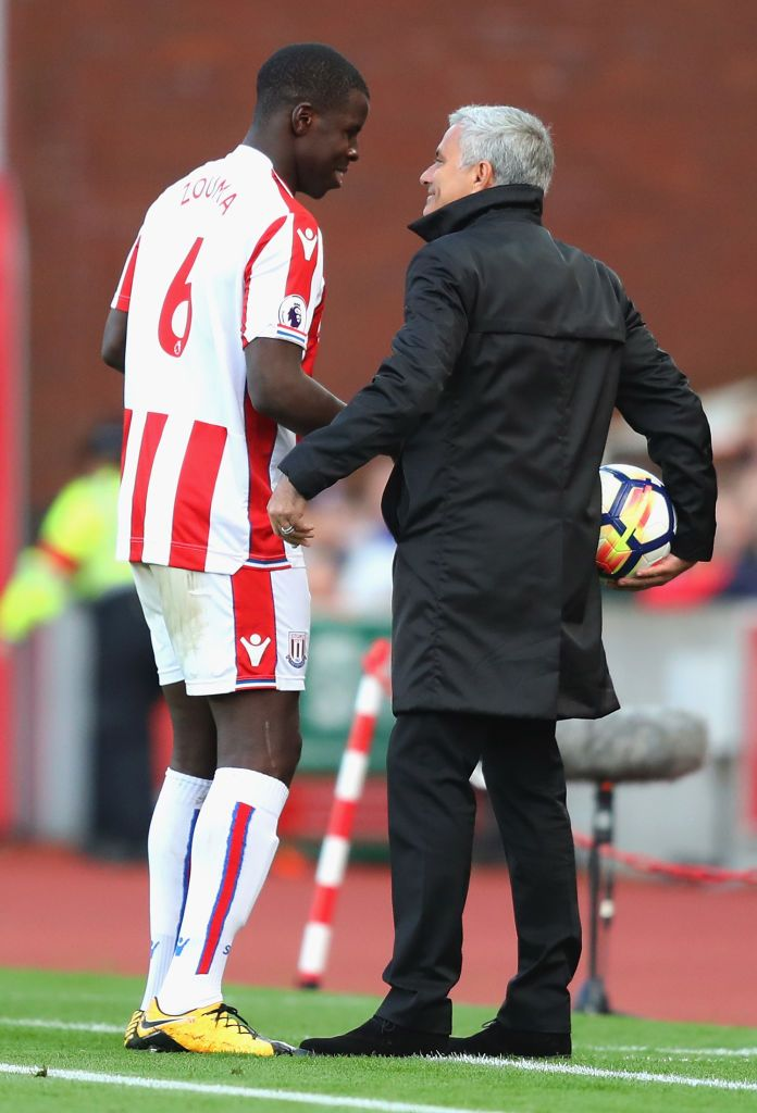 STOKE ON TRENT, ENGLAND - SEPTEMBER 09:  Kurt Zouma of Stoke City and Jose Mourinho, Manager of Manchester United speak during the Premier League match between Stoke City and Manchester United at Bet365 Stadium on September 9, 2017 in Stoke on Trent, England.  (Photo by Richard Heathcote/Getty Images)