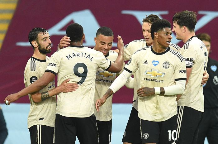 BIRMINGHAM, ENGLAND - JULY 09: Mason Greenwood of Manchester United celebrates with his team mates after scoring his teams second goal during the Premier League match between Aston Villa and Manchester United at Villa Park on July 09, 2020 in Birmingham, England. Football Stadiums around Europe remain empty due to the Coronavirus Pandemic as Government social distancing laws prohibit fans inside venues resulting in all fixtures being played behind closed doors. (Photo by Oli Scarff/Pool via Getty Images)