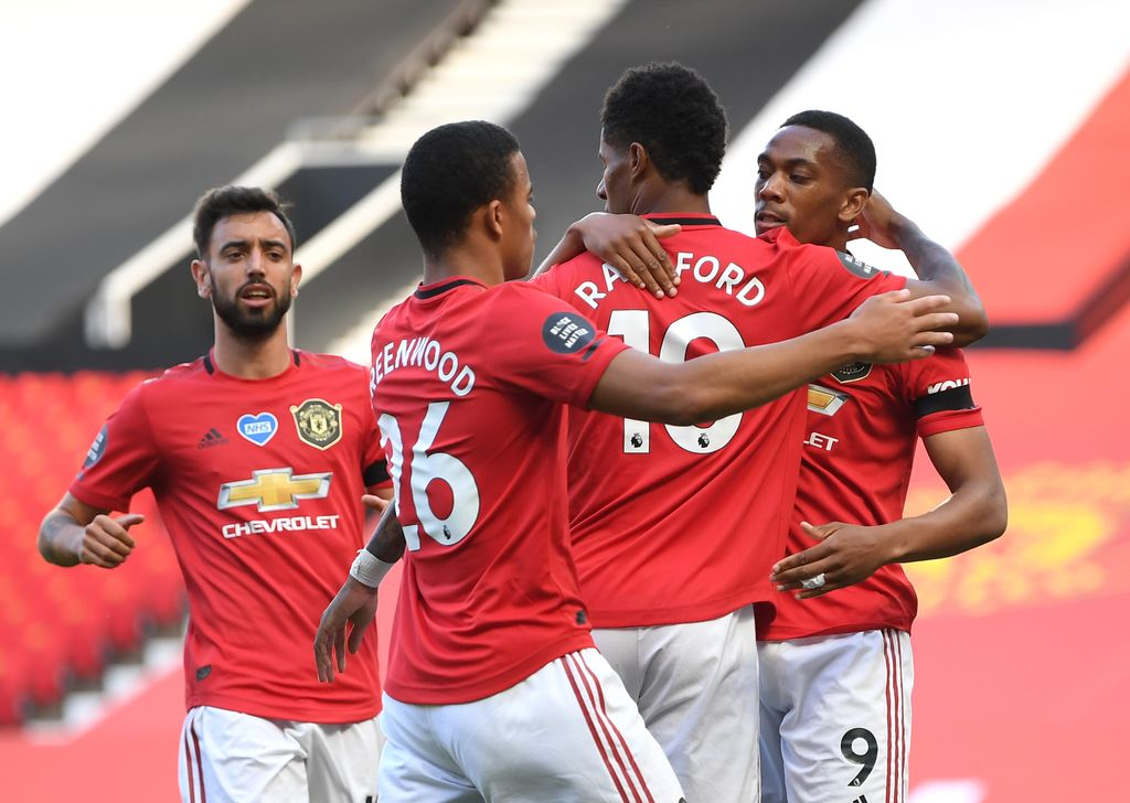 MANCHESTER, ENGLAND - JUNE 24: Anthony Martial of Manchester United celebrates with Marcus Rashford and Mason Greenwood after scoring his team's first goal during the Premier League match between Manchester United and Sheffield United at Old Trafford on June 24, 2020 in Manchester, England. (Photo by Michael Regan/Getty Images)