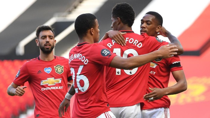 MANCHESTER, ENGLAND - JUNE 24: Anthony Martial of Manchester United celebrates with Marcus Rashford and Mason Greenwood after scoring his teams first goal during the Premier League match between Manchester United and Sheffield United at Old Trafford on June 24, 2020 in Manchester, England. (Photo by Michael Regan/Getty Images)
