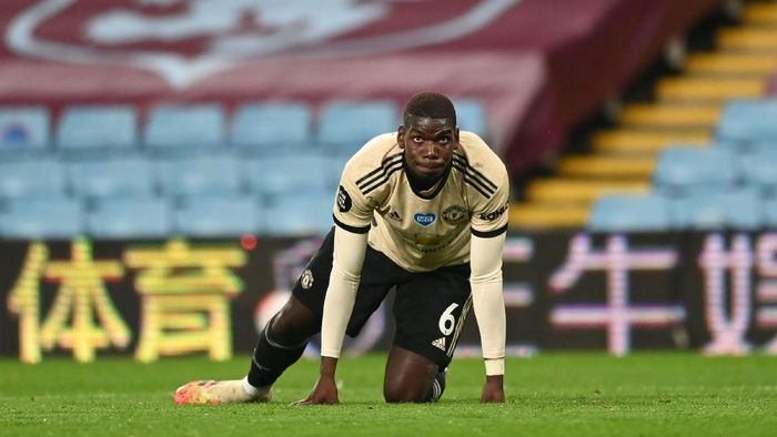 BIRMINGHAM, ENGLAND - JULY 09: Paul Pogba of Manchester United reacts during the Premier League match between Aston Villa and Manchester United at Villa Park on July 09, 2020 in Birmingham, England. Football Stadiums around Europe remain empty due to the Coronavirus Pandemic as Government social distancing laws prohibit fans inside venues resulting in all fixtures being played behind closed doors. (Photo by Shaun Botterill/Getty Images)