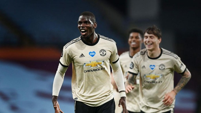 BIRMINGHAM, ENGLAND - JULY 09: Paul Pogba of Manchester United celebrates after scoring his teams third goal during the Premier League match between Aston Villa and Manchester United at Villa Park on July 09, 2020 in Birmingham, England. Football Stadiums around Europe remain empty due to the Coronavirus Pandemic as Government social distancing laws prohibit fans inside venues resulting in all fixtures being played behind closed doors. (Photo by Shaun Botterill/Getty Images)