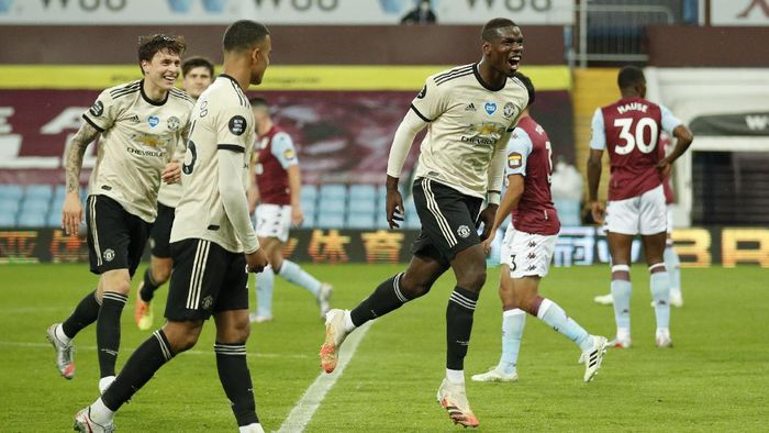 Manchester Uniteds Paul Pogba celebrates after scoring his teams third goal during the English Premier League soccer match between Aston Villa and Manchester United at Villa Park in Birmingham, England, Thursday, July 9, 2020. (AP PhotoAndrew Boyers,Pool)