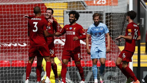 Liverpool's Andrew Robertson, second left, celebrates with teammates after scoring the opening goal of the game during the English Premier League soccer match between Liverpool and Burnley at Anfield, Liverpool, England, Saturday, July 11, 2020. (Clive Brunskill/ Pool via AP)