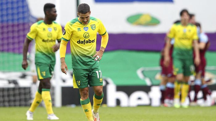 CORRECTS NAME OF PLAYER  Norwich City's Emi Buendia is dejected after West Hams third goal during the English Premier League soccer match between Norwich City and West Ham at the Carrow Road stadium in Norwich, England, Saturday, July 11, 2020. (Alex Pantling/Pool via AP)