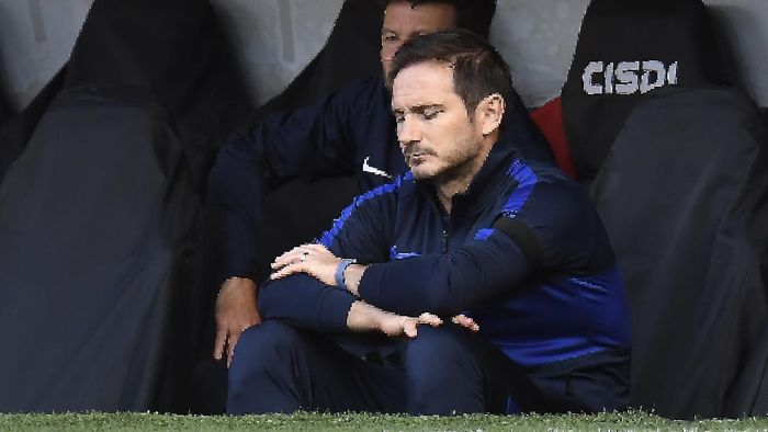 Chelseas head coach Frank Lampard, left, gestures during the English Premier League soccer match between Sheffield United and Chelsea at Bramall Lane in Sheffield, England, Saturday, July 11, 2020. (Peter Powell/Pool via AP)