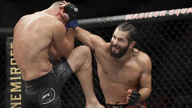 FILE - In this Nov. 3, 2019, file photo, Jorge Masvidal, right, punches Nate Diaz during the second round of a welterweight mixed martial arts bout at UFC 244 in New York. Masvidal had to fly halfway around the world on six days' notice to get the first UFC title shot in his 17-year mixed martial arts career. Masvidal is not mad about the twists that sent him to Abu Dhabi this week with minimal time to train for his fight with Kamaru Usman at UFC 251. (AP Photo/Frank Franklin II, File)