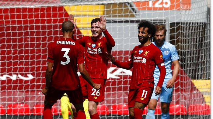 Liverpools Andrew Robertson, second left, celebrates with teammates after scoring the opening goal of the game during the English Premier League soccer match between Liverpool and Burnley at Anfield, Liverpool, England, Saturday, July 11, 2020. (Clive Brunskill/ Pool via AP)