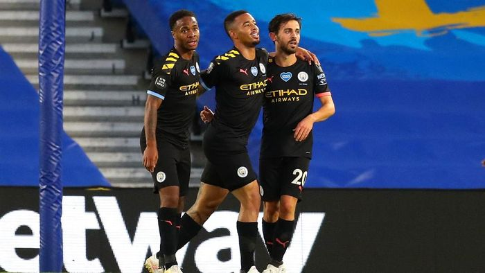 BRIGHTON, ENGLAND - JULY 11: Bernardo Silva of Manchester City celebrates with teammates Gabriel Jesus and Raheem Sterling after scoring his teams fourth goal during the Premier League match between Brighton & Hove Albion and Manchester City at American Express Community Stadium on July 11, 2020 in Brighton, England. Football Stadiums around Europe remain empty due to the Coronavirus Pandemic as Government social distancing laws prohibit fans inside venues resulting in all fixtures being played behind closed doors. (Photo by Catherine Ivill/Getty Images)