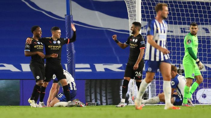 BRIGHTON, ENGLAND - JULY 11: Raheem Sterling of Manchester City celebrates after scoring his teams fifth goal, his hattrick, with team mates Riyad Mahrez and Phil Foden during the Premier League match between Brighton & Hove Albion and Manchester City at American Express Community Stadium on July 11, 2020 in Brighton, England. Football Stadiums around Europe remain empty due to the Coronavirus Pandemic as Government social distancing laws prohibit fans inside venues resulting in all fixtures being played behind closed doors. (Photo by Catherine Ivill/Getty Images)