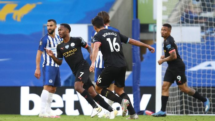 BRIGHTON, ENGLAND - JULY 11: Raheem Sterling of Manchester City celebrates after scoring his teams first goal during the Premier League match between Brighton & Hove Albion and Manchester City at American Express Community Stadium on July 11, 2020 in Brighton, England. Football Stadiums around Europe remain empty due to the Coronavirus Pandemic as Government social distancing laws prohibit fans inside venues resulting in all fixtures being played behind closed doors. (Photo by Julian Finney/Getty Images)