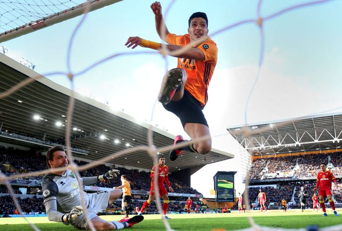 WOLVERHAMPTON, ENGLAND - FEBRUARY 23: Raul Jimenez of Wolverhampton Wanderers scores his teams third goal past Tim Krul of Norwich City during the Premier League match between Wolverhampton Wanderers and Norwich City at Molineux on February 23, 2020 in Wolverhampton, United Kingdom. (Photo by Marc Atkins/Getty Images)