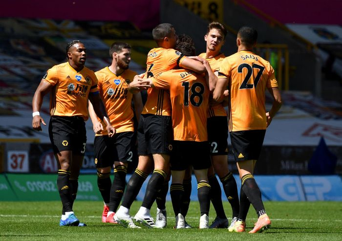 WOLVERHAMPTON, ENGLAND - JULY 12: Diogo Jota of Wolverhampton Wanderers celebrates after he scores his teams third goal during the Premier League match between Wolverhampton Wanderers and Everton FC at Molineux on July 12, 2020 in Wolverhampton, England. Football Stadiums around Europe remain empty due to the Coronavirus Pandemic as Government social distancing laws prohibit fans inside venues resulting in all fixtures being played behind closed doors. (Photo by Ben Stansall/Pool via Getty Images)