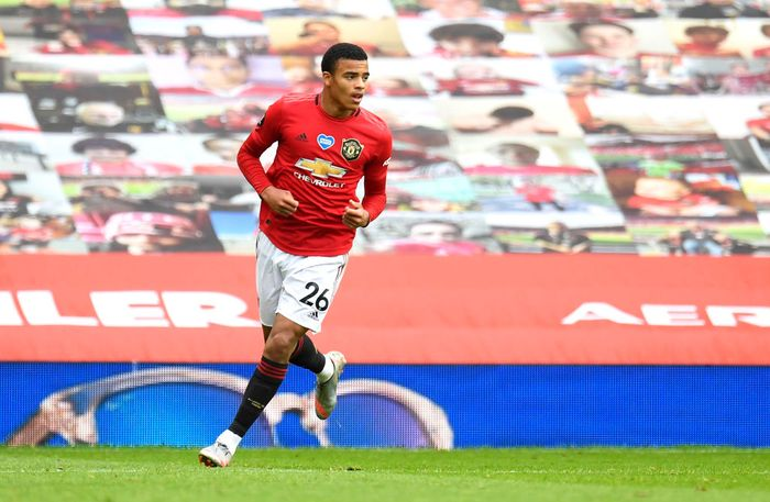 MANCHESTER, ENGLAND - JULY 04: Mason Greenwood of Manchester United celebrates after scoring his teams first goal during the Premier League match between Manchester United and AFC Bournemouth  at Old Trafford on July 04, 2020 in Manchester, England. Football Stadiums around Europe remain empty due to the Coronavirus Pandemic as Government social distancing laws prohibit fans inside venues resulting in all fixtures being played behind closed doors. (Photo by Peter Powell/Pool via Getty Images)