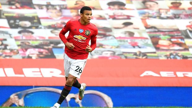 MANCHESTER, ENGLAND - JULY 04: Mason Greenwood of Manchester United celebrates after scoring his team's first goal during the Premier League match between Manchester United and AFC Bournemouth  at Old Trafford on July 04, 2020 in Manchester, England. Football Stadiums around Europe remain empty due to the Coronavirus Pandemic as Government social distancing laws prohibit fans inside venues resulting in all fixtures being played behind closed doors. (Photo by Peter Powell/Pool via Getty Images)