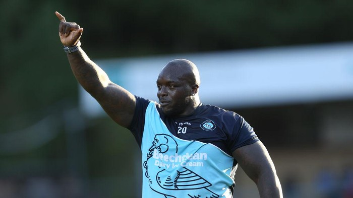 HIGH WYCOMBE, ENGLAND - AUGUST 14: Adebayo Akinfenwa of Wycombe Wanderers acknowledges the Northampton Town fans prior to the Carabao Cup First Round match between Wycombe Wanderers and Northampton Town at Adams Park on August 14, 2018 in High Wycombe, England. (Photo by Pete Norton/Getty Images)