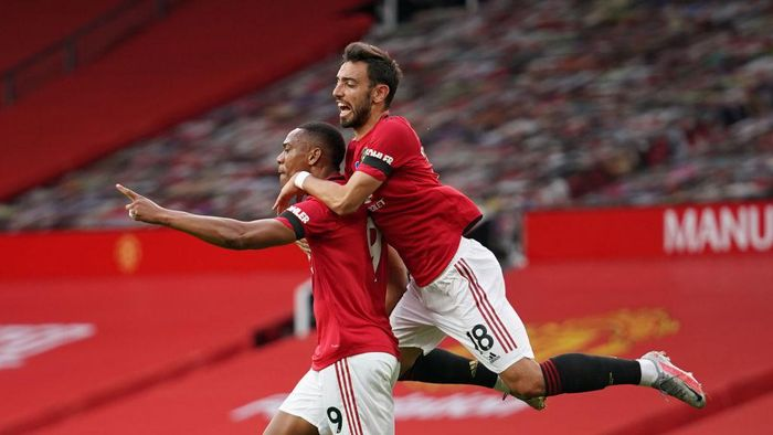 MANCHESTER, ENGLAND - JULY 13: Anthony Martial of Manchester United celebrates with teammates Bruno Fernandes and Marcus Rashford of Manchester United after scoring his teams second goal during the Premier League match between Manchester United and Southampton FC at Old Trafford on July 13, 2020 in Manchester, England. Football Stadiums around Europe remain empty due to the Coronavirus Pandemic as Government social distancing laws prohibit fans inside venues resulting in all fixtures being played behind closed doors. (Photo by Dave Thompson/Pool via Getty Images)