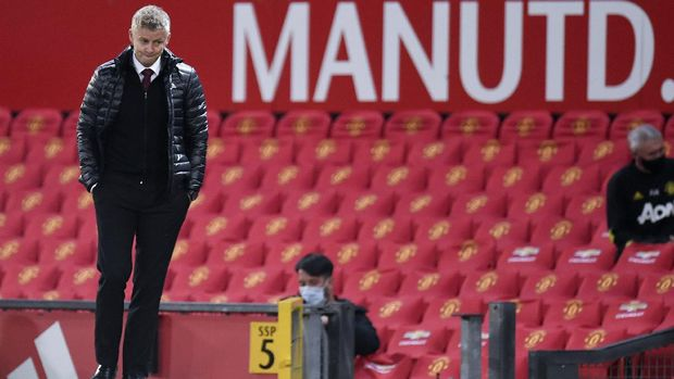 Manchester United's manager Ole Gunnar Solskjaer reacts after the English Premier League soccer match between Manchester United and Southampton at Old Trafford in Manchester, England, Monday, July 13, 2020. (AP Photo/Peter Powell,Pool)