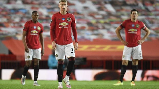 Manchester United's Scott McTominay reacts after the English Premier League soccer match between Manchester United and Southampton at Old Trafford in Manchester, England, Monday, July 13, 2020. (AP Photo/Peter Powell,Pool)
