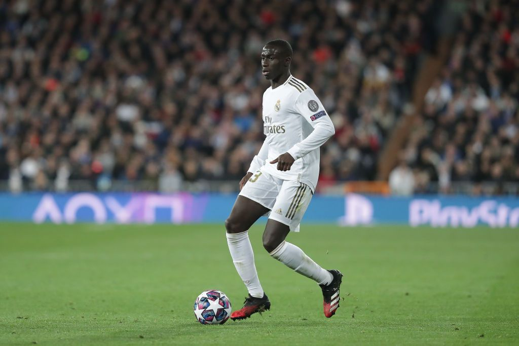 GRANADA, SPAIN - JULY 13:  Ferland Mendy of Real Madrid celebrates scoring the opening goal during the Liga match between Granada CF and Real Madrid CF at on July 13, 2020 in Granada, Spain. Football Stadiums around Europe remain empty due to the Coronavirus Pandemic as Government social distancing laws prohibit fans inside venues resulting in all fixtures being played behind closed doors. (Photo by Fran Santiago/Getty Images)