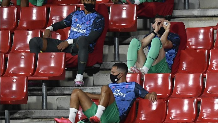 Real Madrids Gareth Bale, right, gestures from the stands ahead of the Spanish La Liga soccer match between Granada and Real Madrid at the Los Carmenes stadium in Granada, Spain, Monday, July 13, 2020. (AP Photo/Jose Breton)