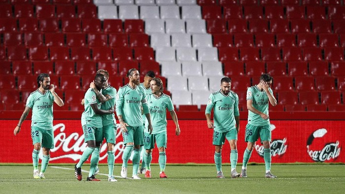 GRANADA, SPAIN - JULY 13:  Ferland Mendy of Real Madrid is congratulated after scoring the opening goal during the Liga match between Granada CF and Real Madrid CF at on July 13, 2020 in Granada, Spain. Football Stadiums around Europe remain empty due to the Coronavirus Pandemic as Government social distancing laws prohibit fans inside venues resulting in all fixtures being played behind closed doors. (Photo by Fran Santiago/Getty Images)