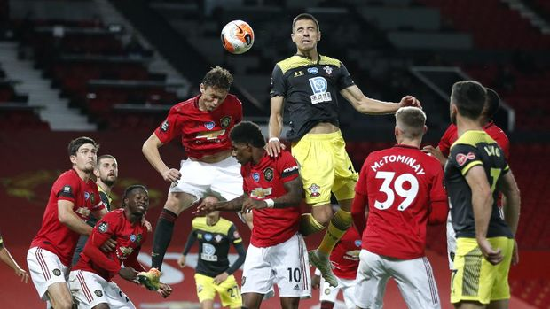 Southampton's Jan Bednarek heads the ball during the English Premier League soccer match between Manchester United and Southampton at Old Trafford in Manchester, England, Monday, July 13, 2020. (AP Photo/Clive Brunskill,Pool)